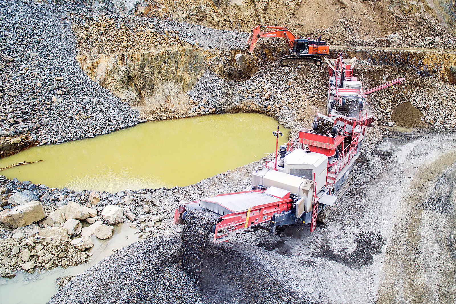 Wide shot of quarry with Hitachi ZX470LCH-5