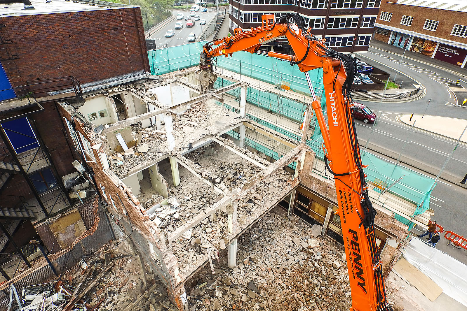 Hitachi ZX350LC-5 high-reach demolition excavator demolishing building