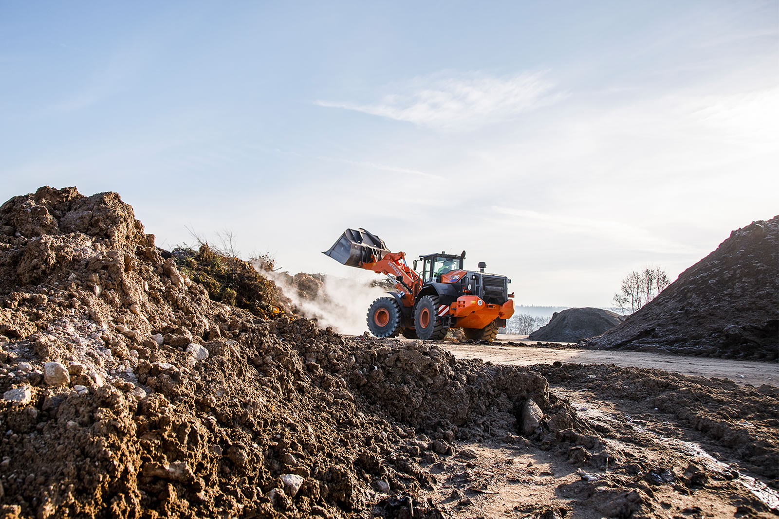Hitachi ZW310-6 wheel loader moving around on site in Germany