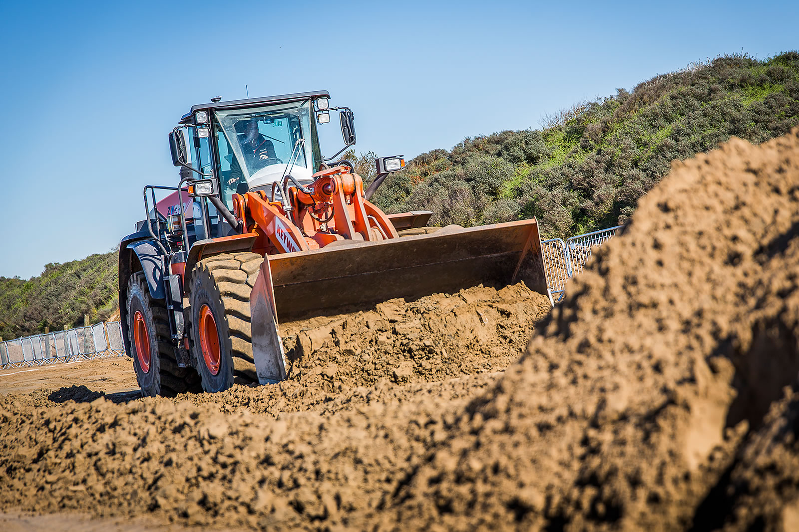 Hitachi ZW310-6 wheel loader with a standard 4.3m3 bucket moves sand