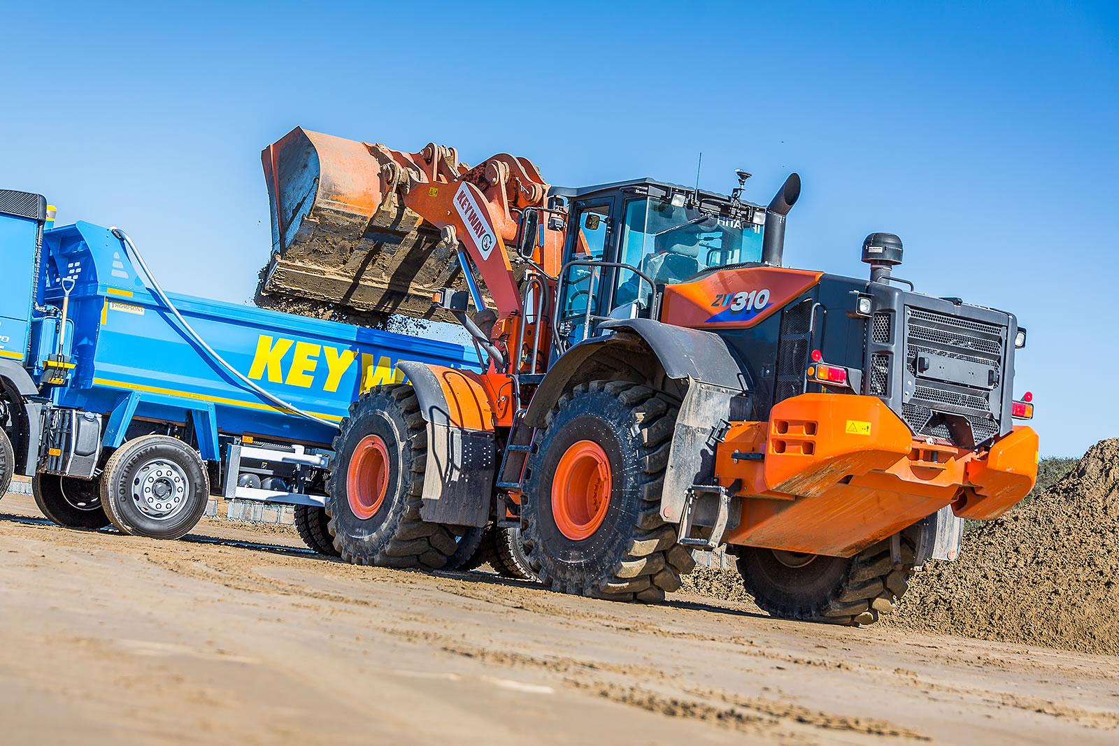 Hitachi ZW310-6 wheel loader unloading material on Weston beach