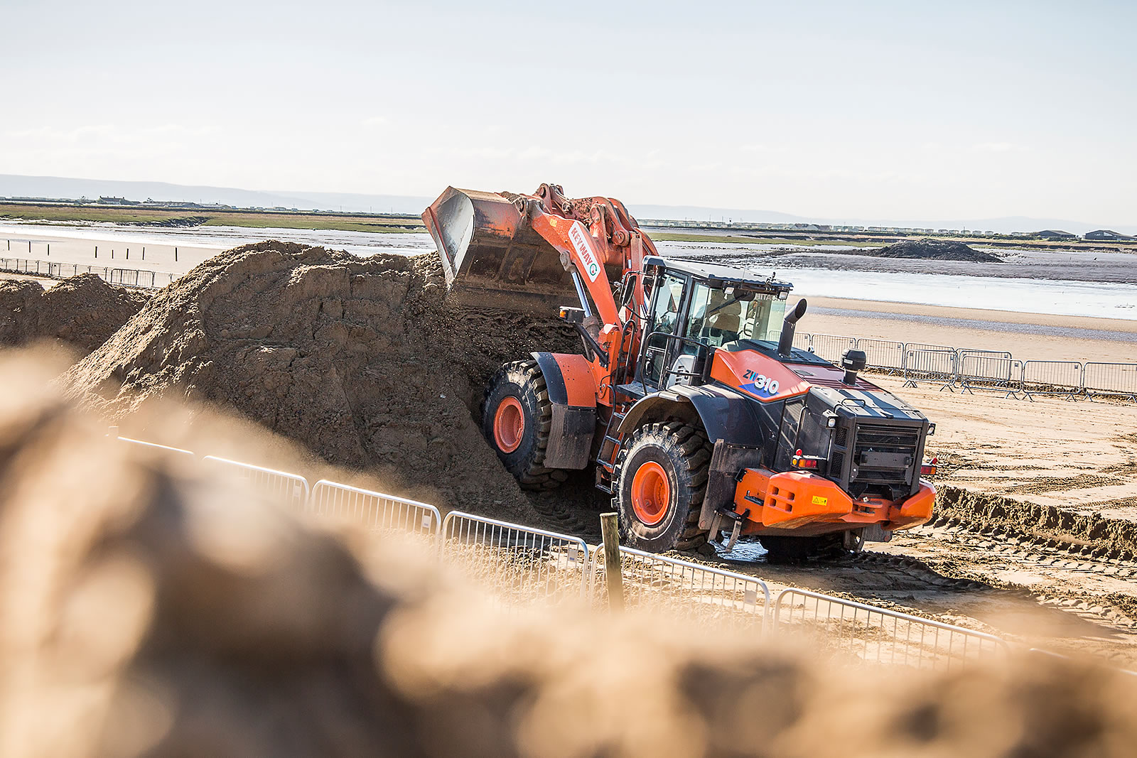 Hitachi ZW310-6 wheel loader helps to build obstacles for the Weston Beach Race