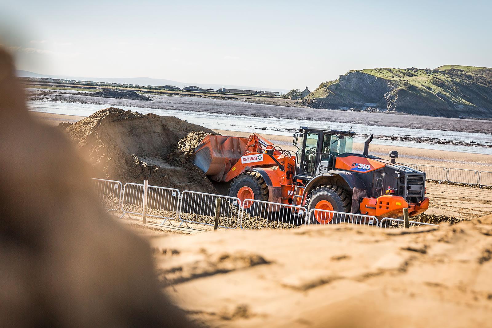 Hitachi ZW310-6 wheel loader working on Weston-Super-Mare beach