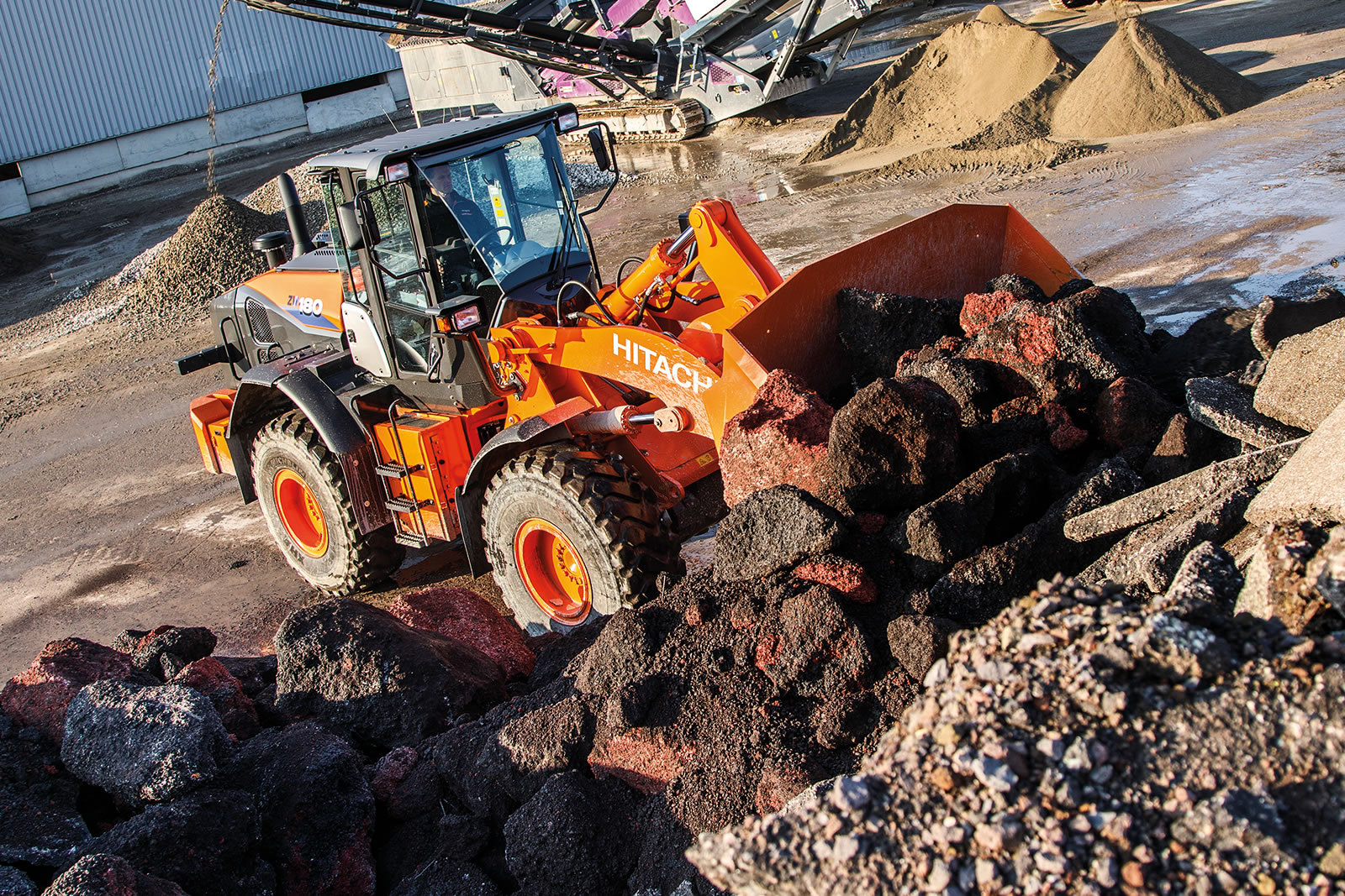 Hitachi ZW180-6 wheel loader moves materials