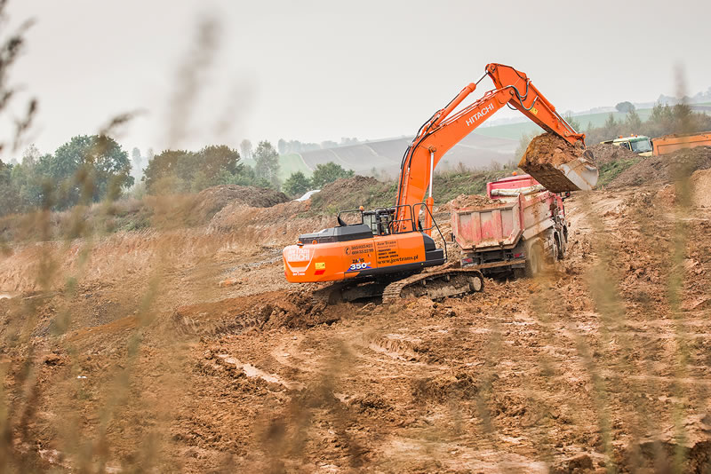 Hitachi ZX350LC-6 excavator earthmoving on the 50km stretch of road