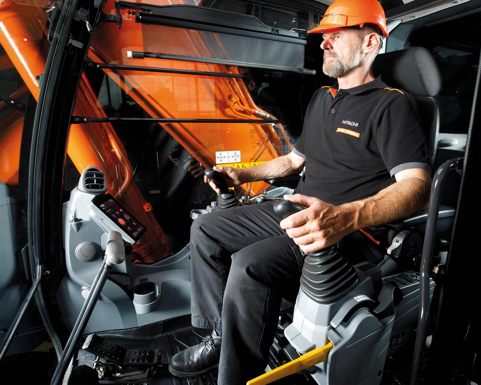 Operator in the Hitachi Zaxis-7 excavator cab